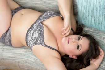 Woman in lingerie laying on couch